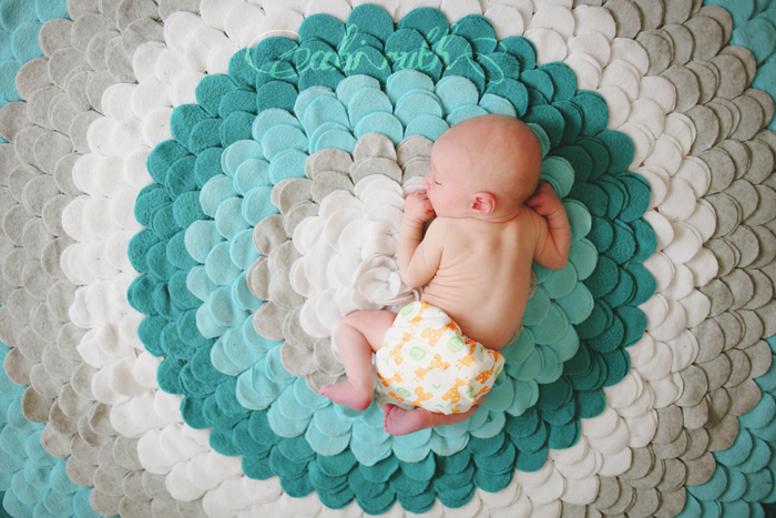 baby sleeping on felt rug