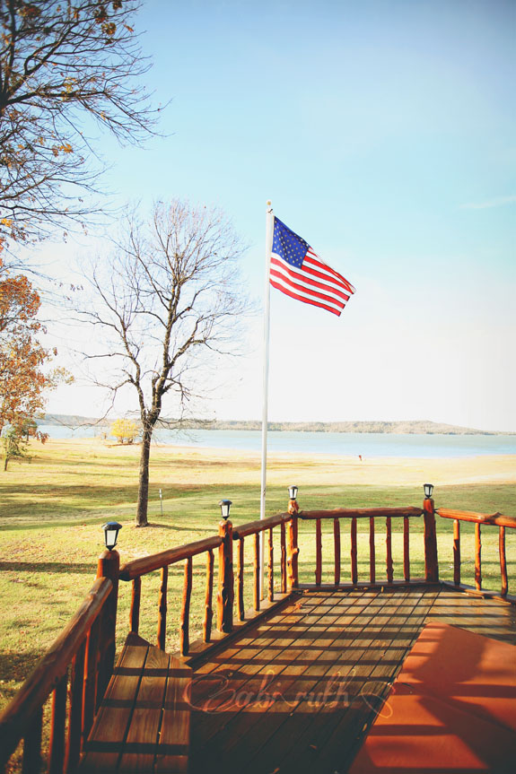 american flag at lake wedding