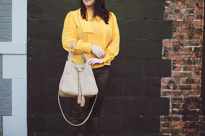 007 yellow blouse black gold pants outfit