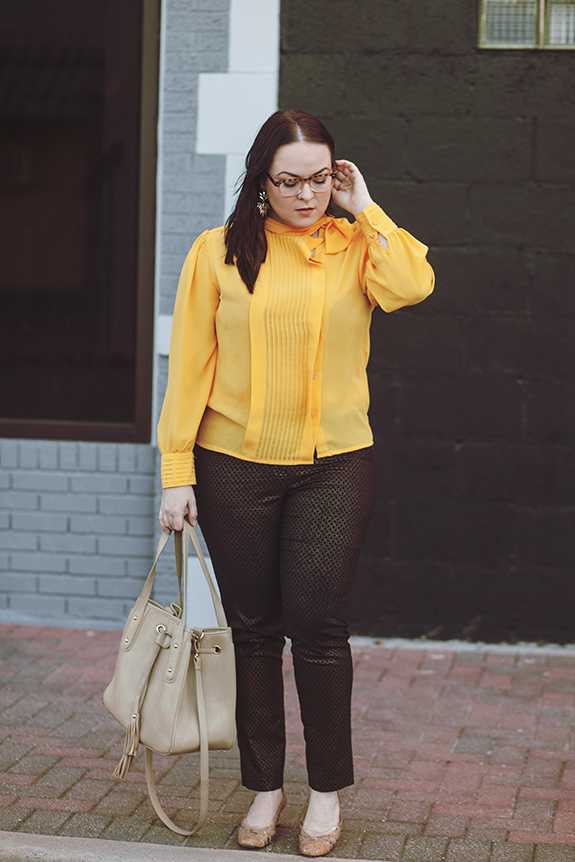 015 yellow blouse black gold pants outfit